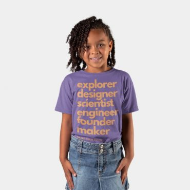 Little girl smiling wearing purple smart girls squad t-shirt for kids